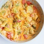 This easy creamy tortellini recipe with garlic, broccoli and tomato is made in under 30 minutes, in one pan and will satisfy all your creamy pasta cravings. A super easy weeknight dinner recipe that everyone will love!