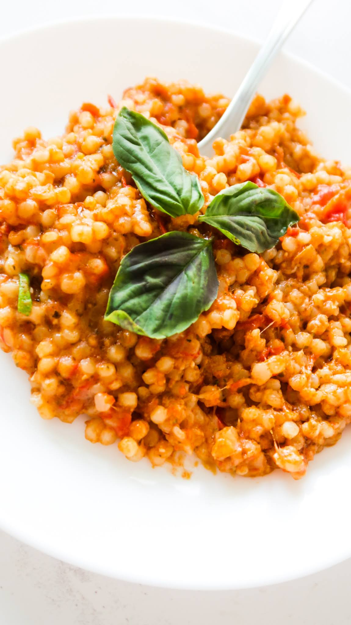 Tomato basil couscous recipe! This is an easy pasta dish that is super tasty and only 6 ingredients. Super quick vegetarian healthy weeknight dinner or side dish!