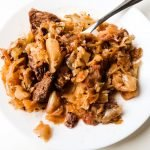 Easy pork and sauerkraut! This is an easy keto pork recipe that you will love if you like sauerkraut! This low carb dinner is perfect for the cold months and it's delicous! Plus anyone can make this sauerkraut recipe - it's super simple and only 5 ingredients!