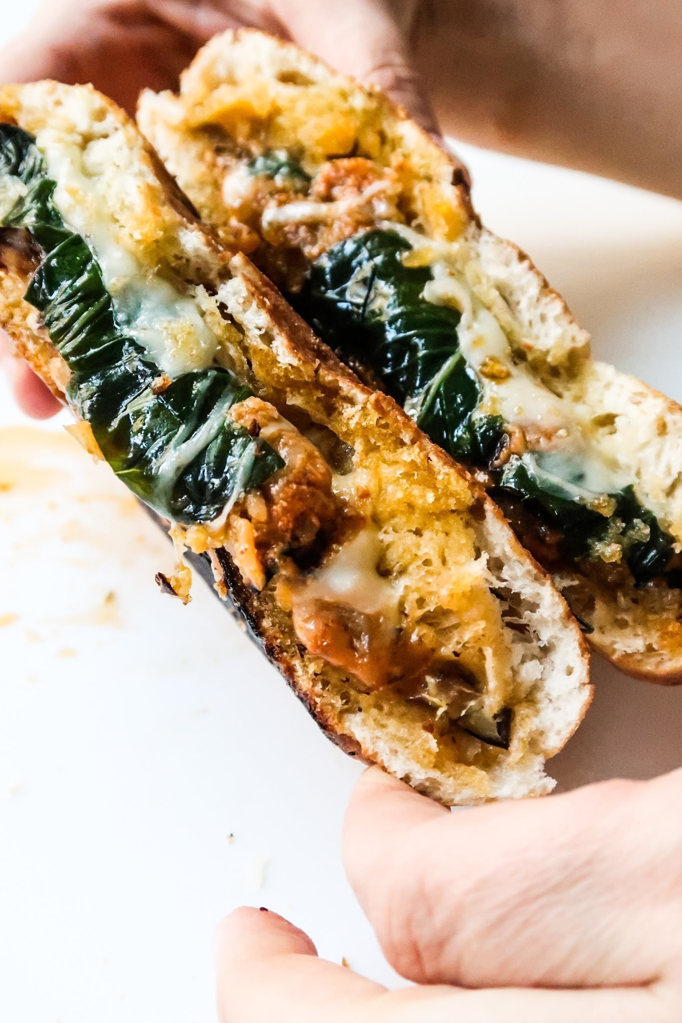 Super delicious garlic eggplant panini recipe! Don't make a regular grilled cheese sandwich - make this delicious pesto garlic and eggplant parmesan panini - it's a vegetarian eggplant recipe that is easy and incredibly delicious. It haunts me every day since I made it! #sandwich #pesto #panini #eggplant #recipe #easy