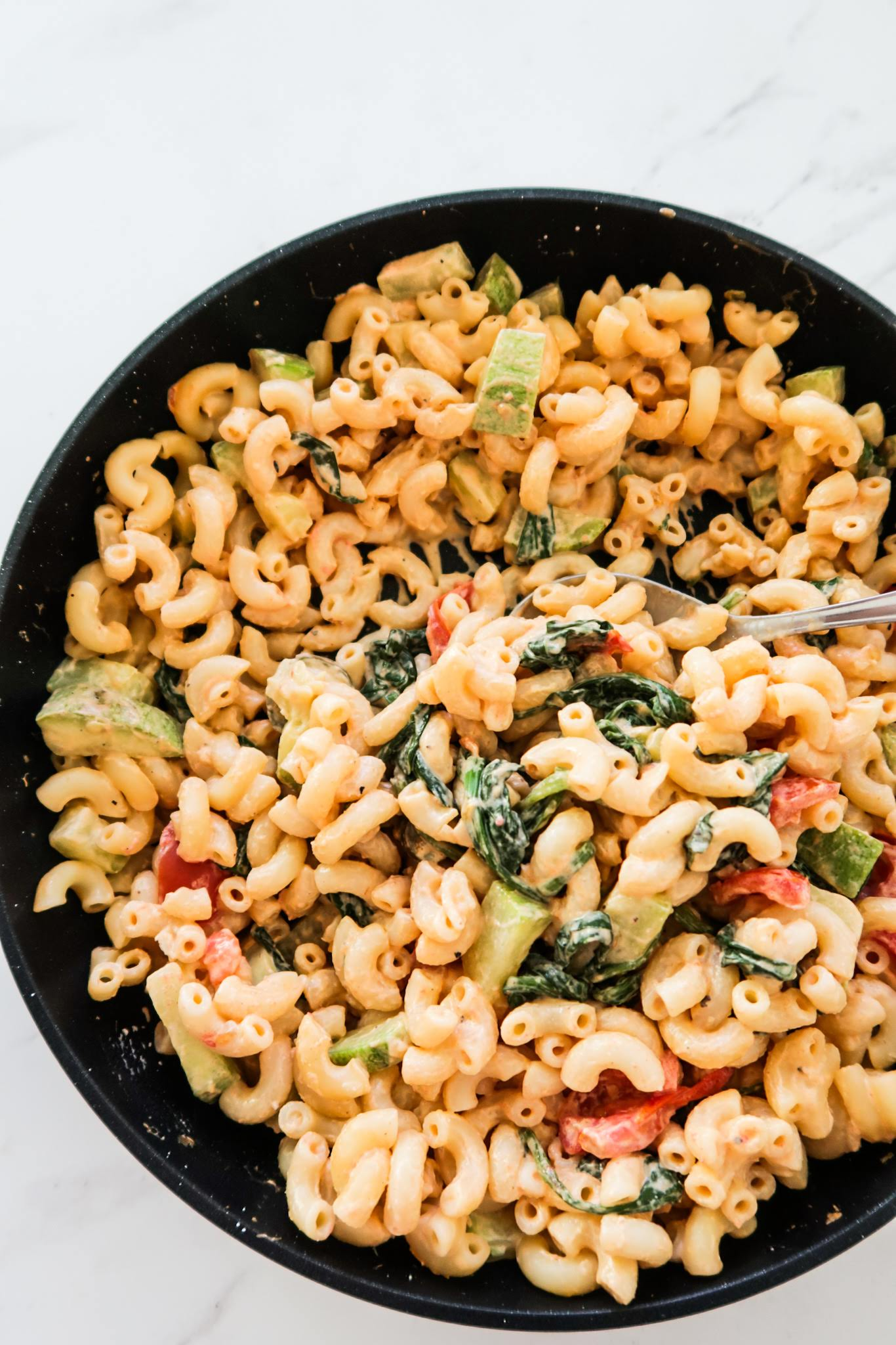 An easy creamy pasta recipe with cream cheese, spinach and zucchini. This garlicky vegetarian pasta is a healthy (ish) quick dinner idea that you'll love!
