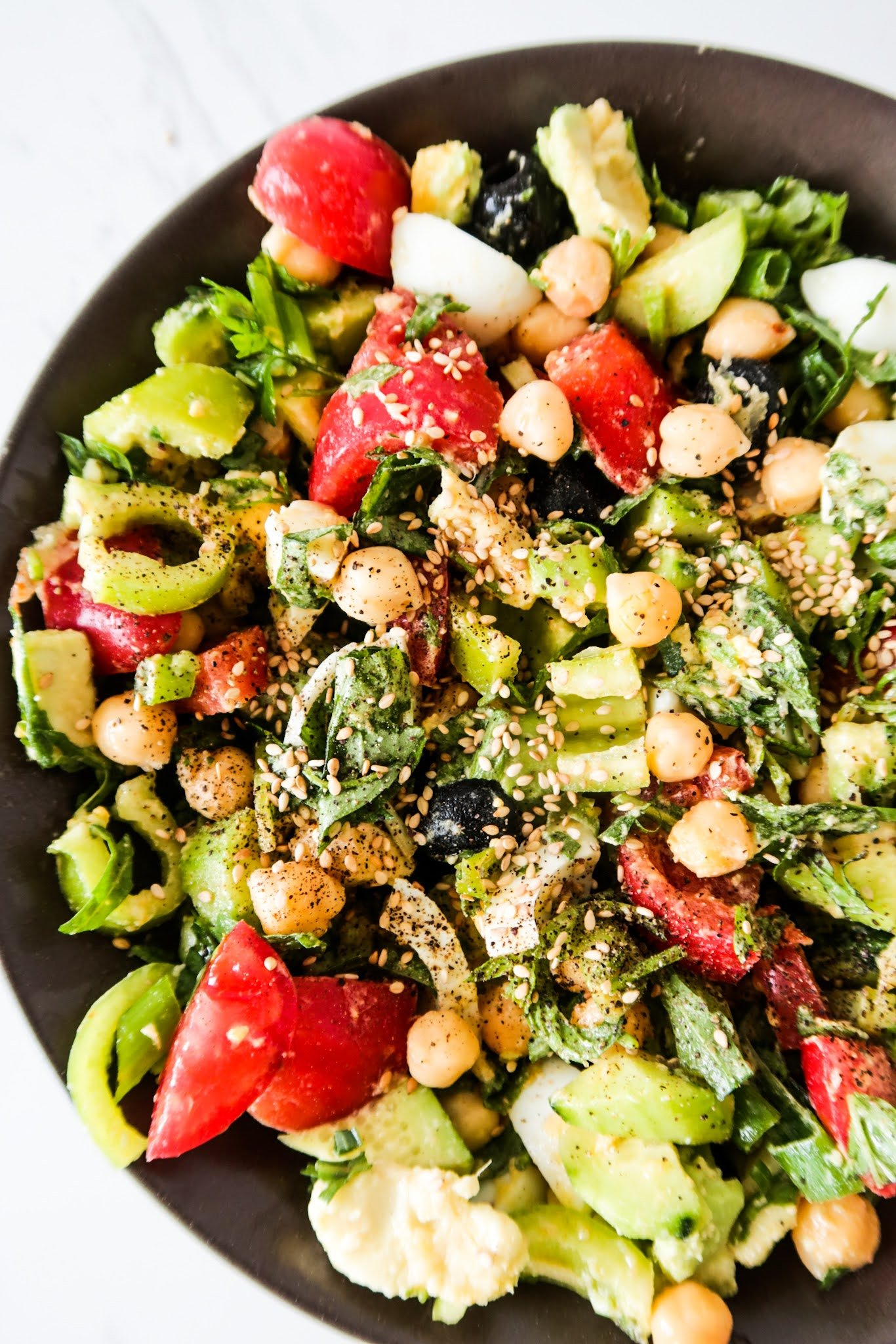 This is an easy and healthy egg and chickpea salad recipe that is protein packed and great for a filling gluten-free lunch. Filled with fresh produce this vegetarian healthy salad is great for summer!