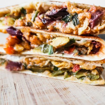 Need a quick and easy dinner recipe for busy weeknights? Try this 10-Minute tasty, spicy chicken quesadilla recipe with feta cheese that's healthy but doesn't taste like health! This easy meal is filled with tasty healthy ingredients: shredded chicken (a great way to use leftovers!), avocado, feta cheese, herbs, spices and last but not least: garlic. Great quick dinner idea for clean eating!