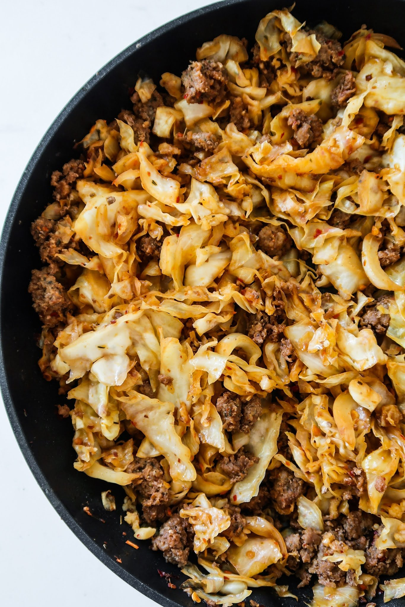 This 30-Minute healthy ground beef and cabbage recipe is low carb, gluten free dairy free, spicy and an absolutely delicious healthy dinner idea for busy weeknights!