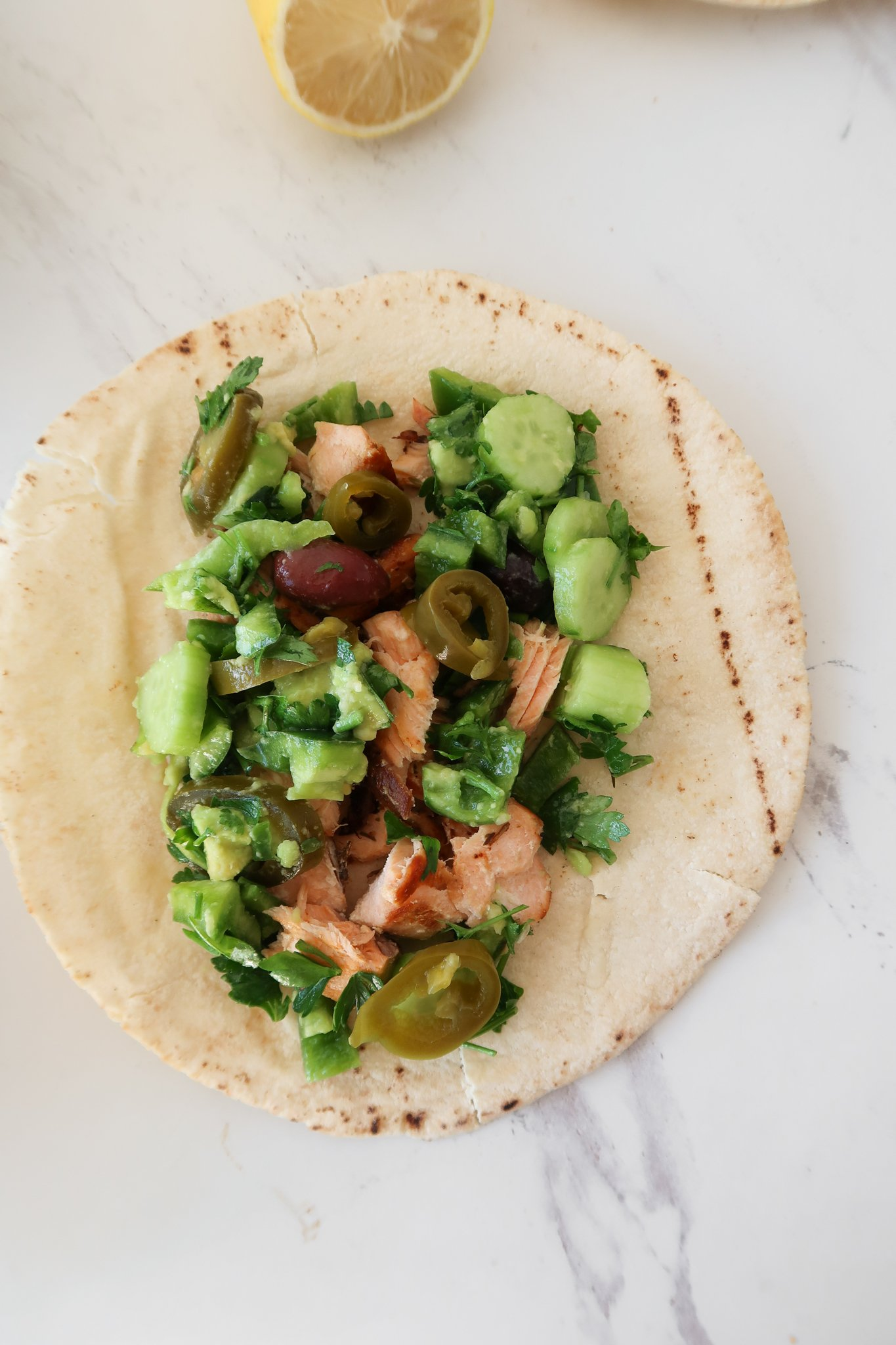 Mediterranean salmon wraps: a 30-minute delicious healthy dinner idea! So easy and quick, this salmon recipe makes 3 servings and is great for meal prep too!
