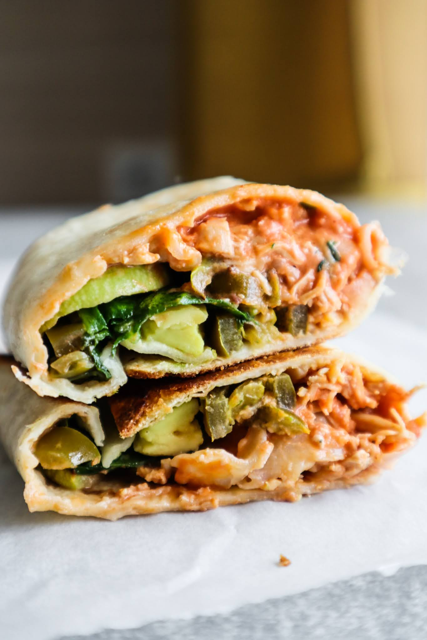 Try these 15-minute healthy spicy chicken wraps for a quick and easy lunch idea! They're super delicious, satisfying and it's easy to adjust the recipe if you don't have/like an ingredient!