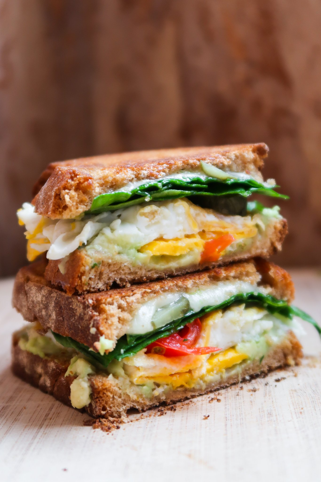 healthy breakfast sandwich recipe! This is the perfect vegetarian savory breakfast idea: an avocado egg breakfast sandwich. It's so so good, you'll want to make this easy egg sandwich every single morning!