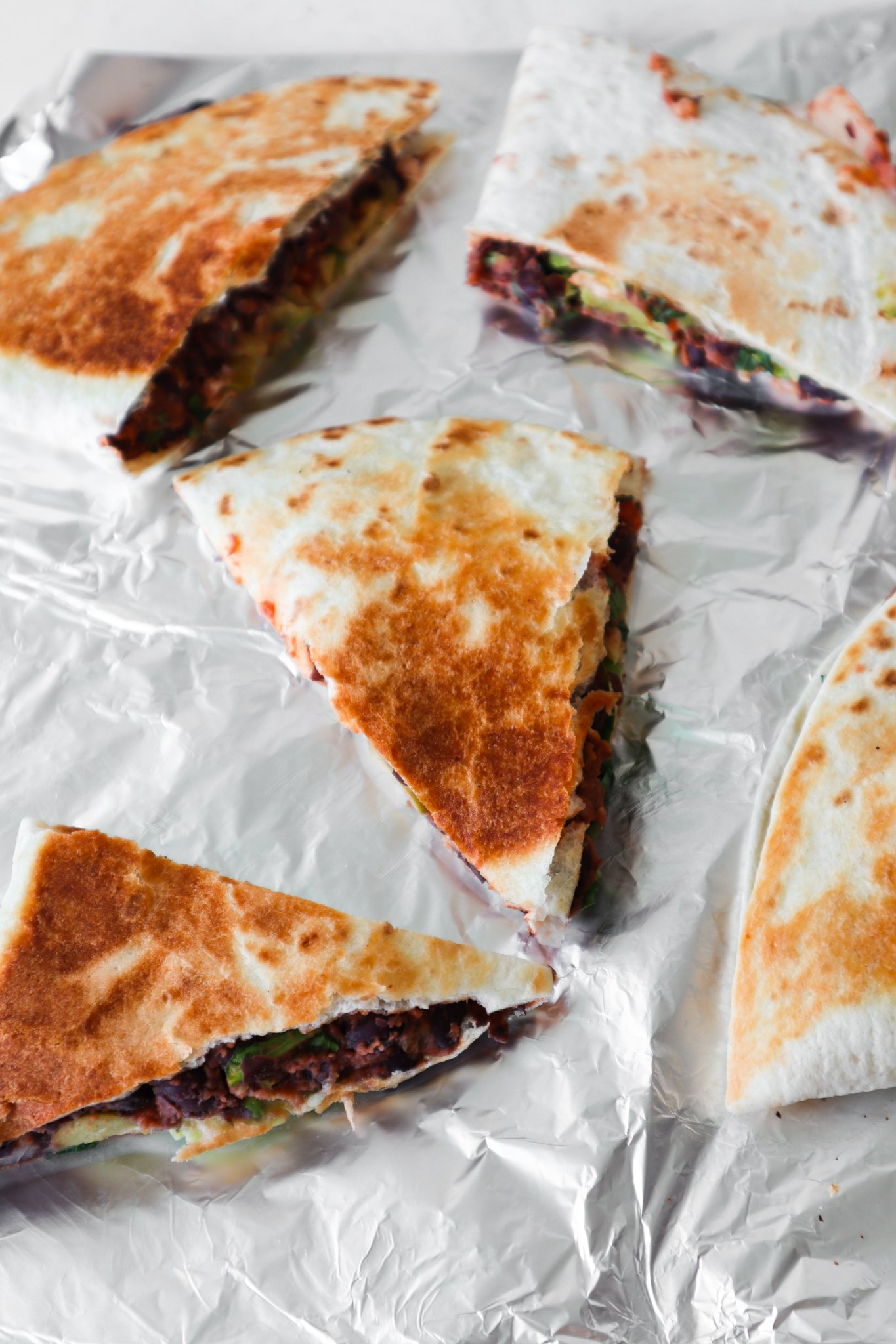This avocado black bean quesadilla is a delicious meatless dinner recipe that you can make in 10 minutes