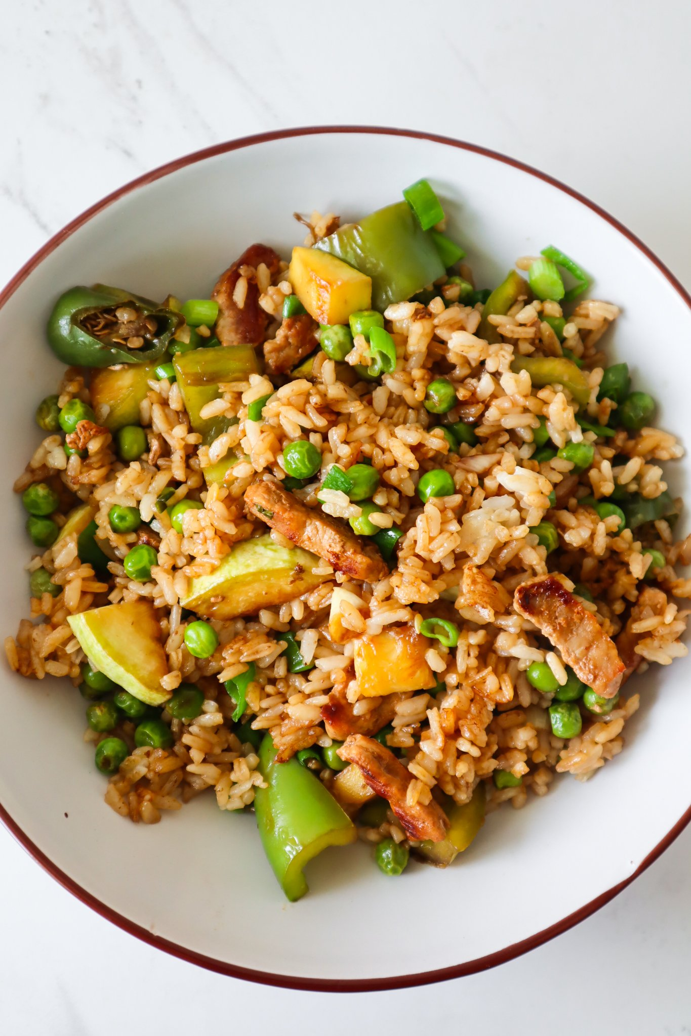 Make this healthy rice and chicken dinner skillet in no time using chicken breast, cooked rice, frozen peas and whatever vegetables you have at home! This is the best quick and easy chicken and rice recipe and you will only need one pan.
